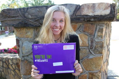 Sara Chesnut holds up her acceptance letter to Young Harris College. She is excited to attend the same college as her father, sister and many other family alumni.