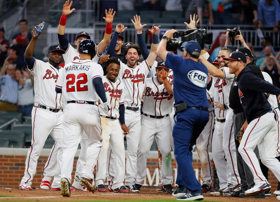 The+Braves+celebrate+a+homerun+made+by+Nick+Markakis%2C+a+common+occurrence+this+season+with+how+well+they+are+doing.+Currently%2C+they+are+leading+the+National+League+East.+Photo+by+Jeff+Schafer.