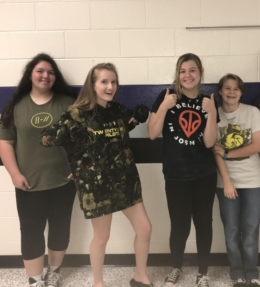 """Local Raiders Andrea Escobar, Cynda Allen (myself), Emily Prior, and Jewel Reynolds are showing their love and support for Twenty One Pilots and their newest album """"Trench."""