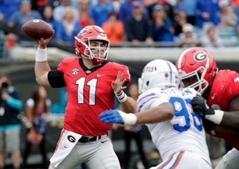 Georgia's quarterback, Jake Fromm, is shown looking to throw the ball to his fellow teammates. (Photo from Associated Press.)