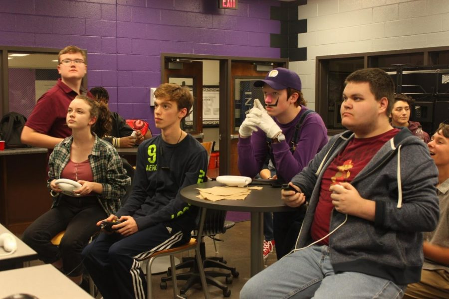 Three Mario Kart Tournament racers, Cara Cobb, 11th (left), Jonah Wagner, 10th (left middle), and JD Nieman, 9th (far right), compete in the final race to determine the winner of the tournament.