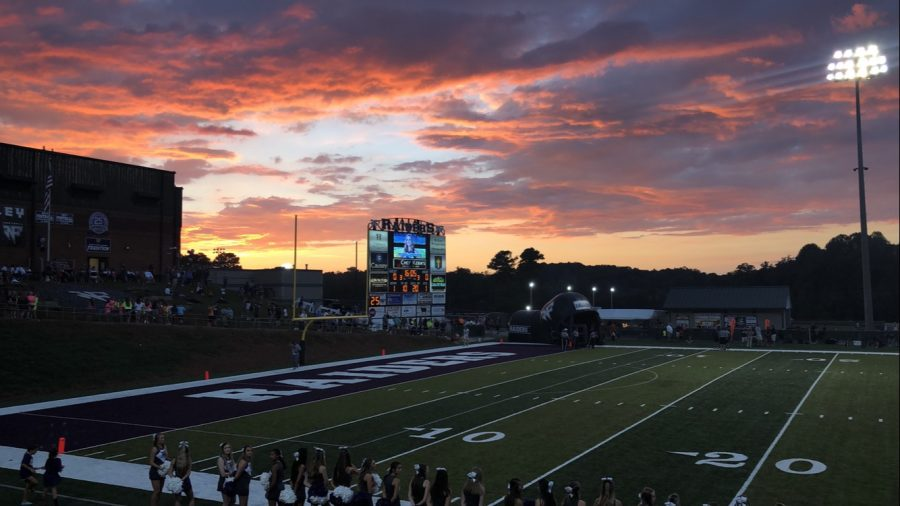 A+beautiful+sunset+gathers+over+Raider+Valley+as+players+get+ready+for+their+entrance+on+field.