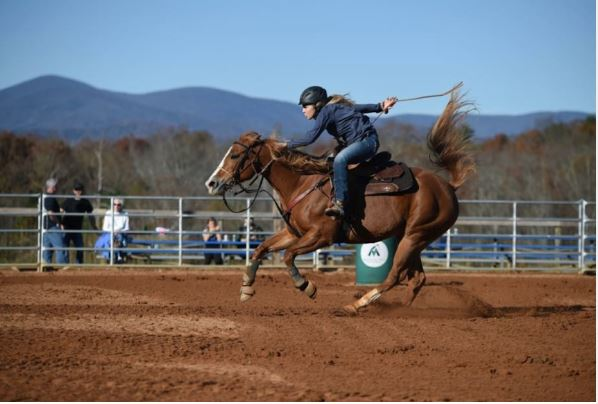 Grace Orzech, a freshman at North Forsyth High School is running her horse Kat at Mountain View Stables and Arena.