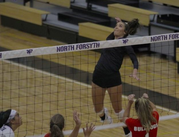 Mary Ellen Enright jumps to spike the ball during North Forsyth High School's volleyball match against Forsyth Central High School on Sept. 5, 2018. (Photo by Ian Frazer.)