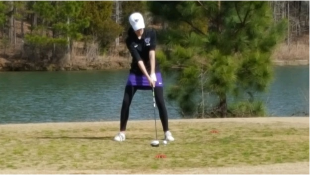 Junior Grace Wood gets ready to hit a long drive on to the fairway. Photo by Billy Wood.