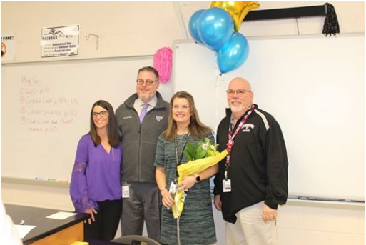 Mrs. Amy Dykes standing with members of the NFHS staff after she learned that she had been chosen as one of seven finalists for District Teacher of the Year. (Photo credit to NFHS Facebook page.)