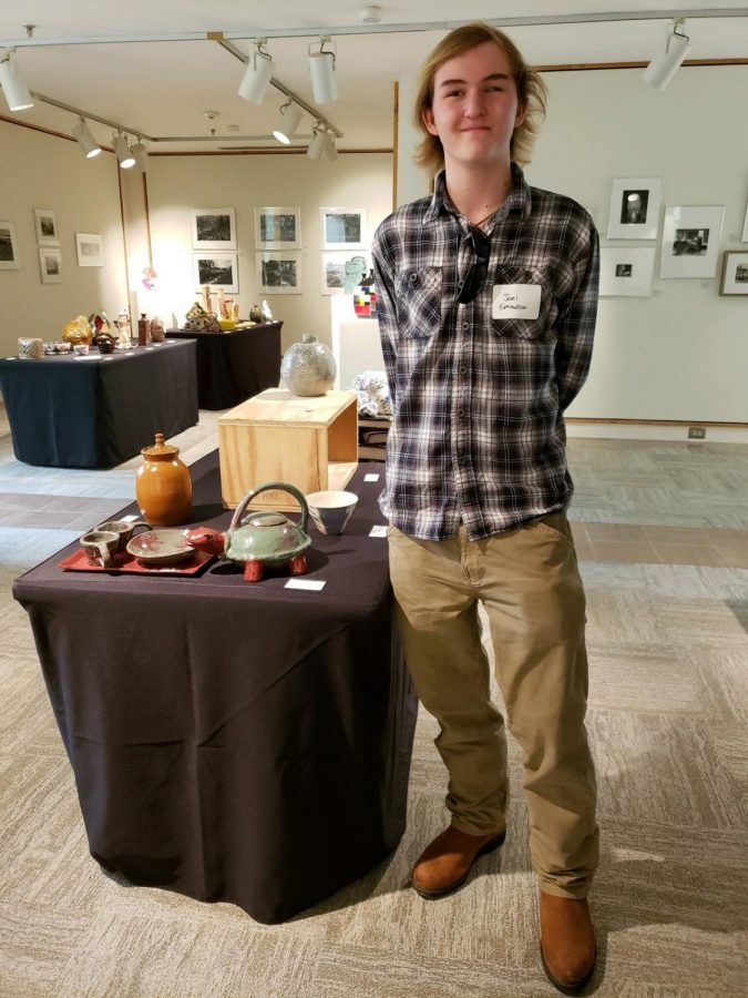 "North junior Joel Edmonson stands next to his piece, titled ""Turtle Teapot."""
