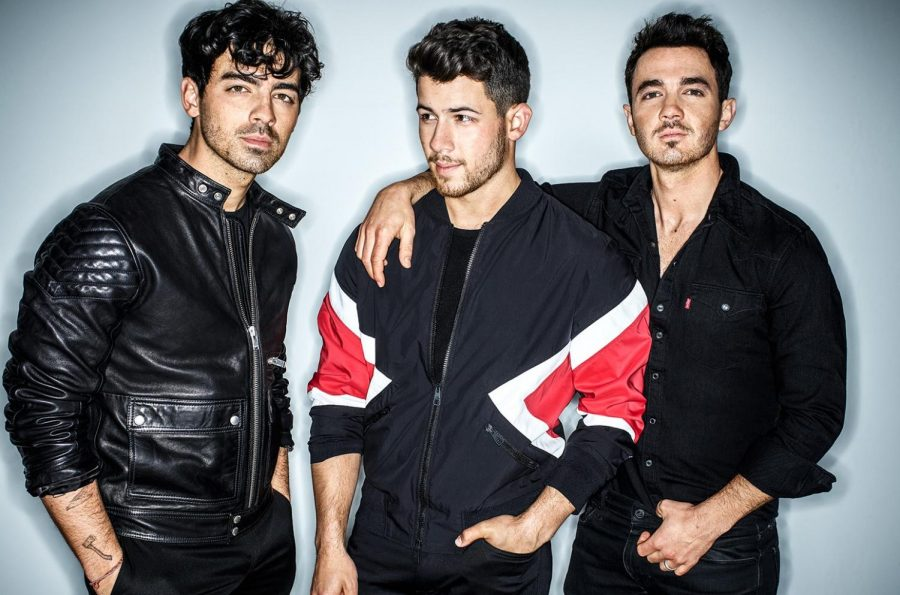 Caption%3A+The+Jonas+Brothers+made+an+unexpected+but+much+needed+return+in+early+2019.+The+band+not+only+reunited%2C+but+they+also+released+a+single+immediately+after+announcing+their+comeback.+%28Photo+credits%3A+Billboard+Magazine--https%3A%2F%2Fwww.billboard.com%2Farticles%2Fcolumns%2Fchart-beat%2F8500981%2Fjonas-brothers-return-pop-songs-chart-new-single-sucker.%29