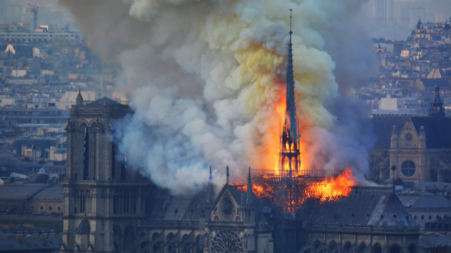 The Notre Dame Cathedral in France caught fire on Apr. 15. France mourns the loss of the heart of the country, a beloved piece of gothic art and a symbol of the Catholic Church. (Photo by www.axios.com.)