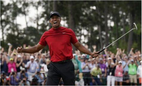 Tiger Woods celebrates winning the Masters for now the fifth time and winning his first major championship in years. (Photo by Getty Images.)