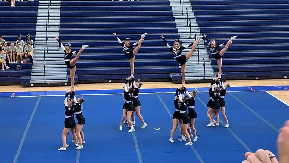 Competition cheer team during the stunt section at their first competition.