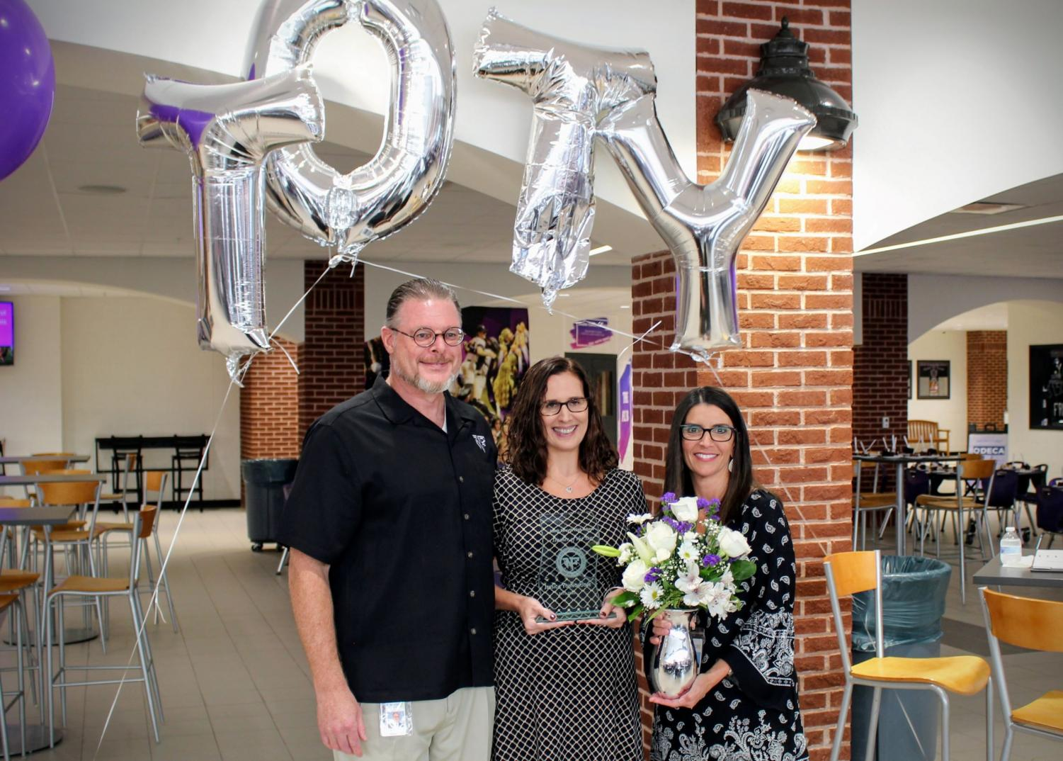Mrs. Younghouse stands next to Mr. Jeff Cheney and Mrs. Kim Oliver; she has just received the Teacher of the Year award. Photo submitted by: North Forsyth High School Home Page