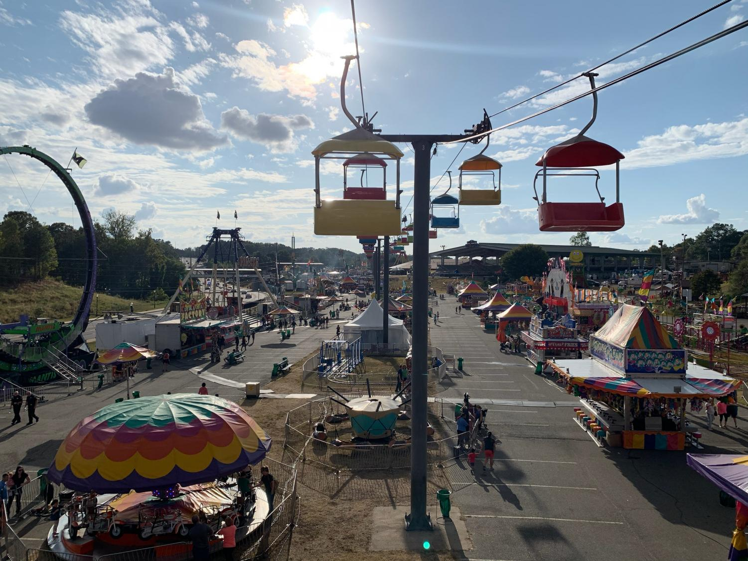 An overview of the fair featuring many rides such as the mantis, sky buckets, and priate ship. Photo by: Anes Ribic