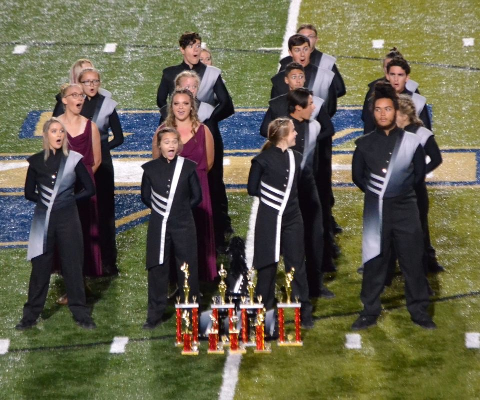 Band officers celebrate as they find out their percussion won first place overall. Photo by: Wolverine Classic photo staff.