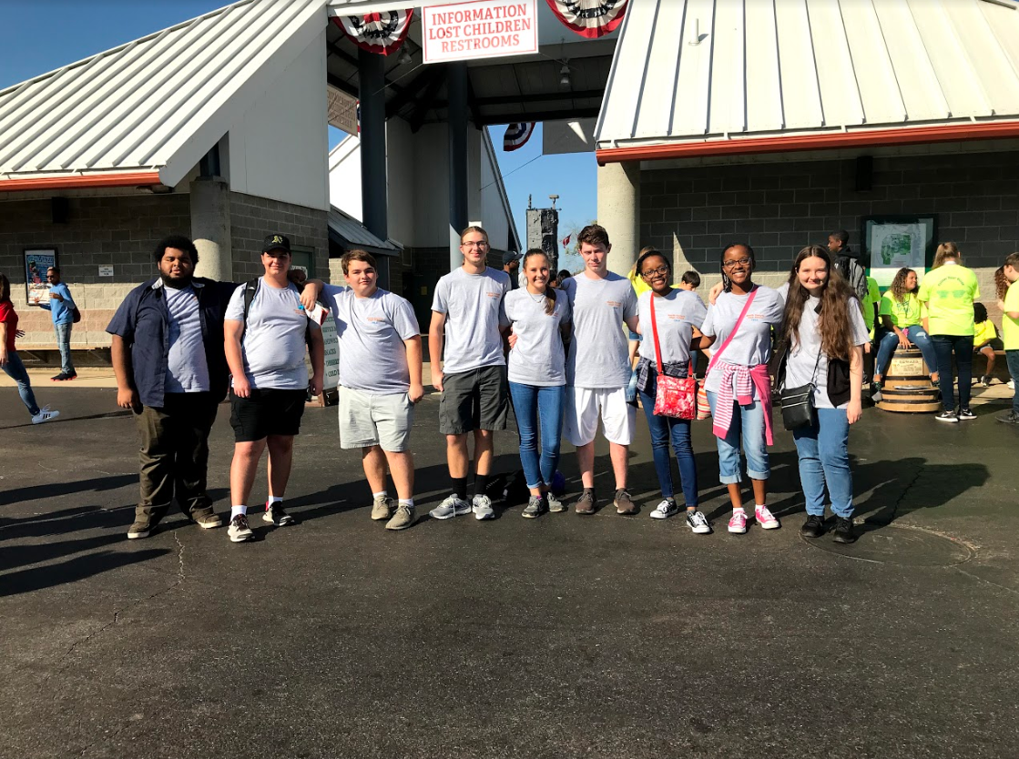 North Forsyth's chapter of FBLA poses in the entrance of the Georgia National Fairgrounds.