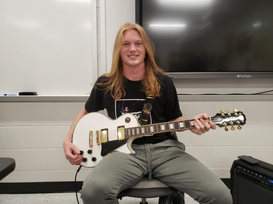 "There is a new addition to Wellness Wednesday called ""Classic Rock Music Hour."" The image above is senior Tyler Hogan, who plays the guitar for the session."