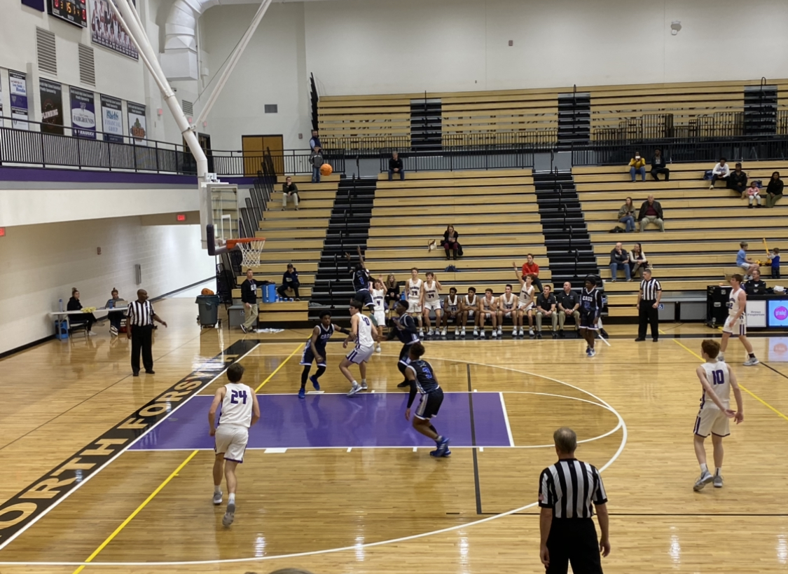 Bennett Helms shoots and scores three points during the second quarter. photo by; Melody Scott