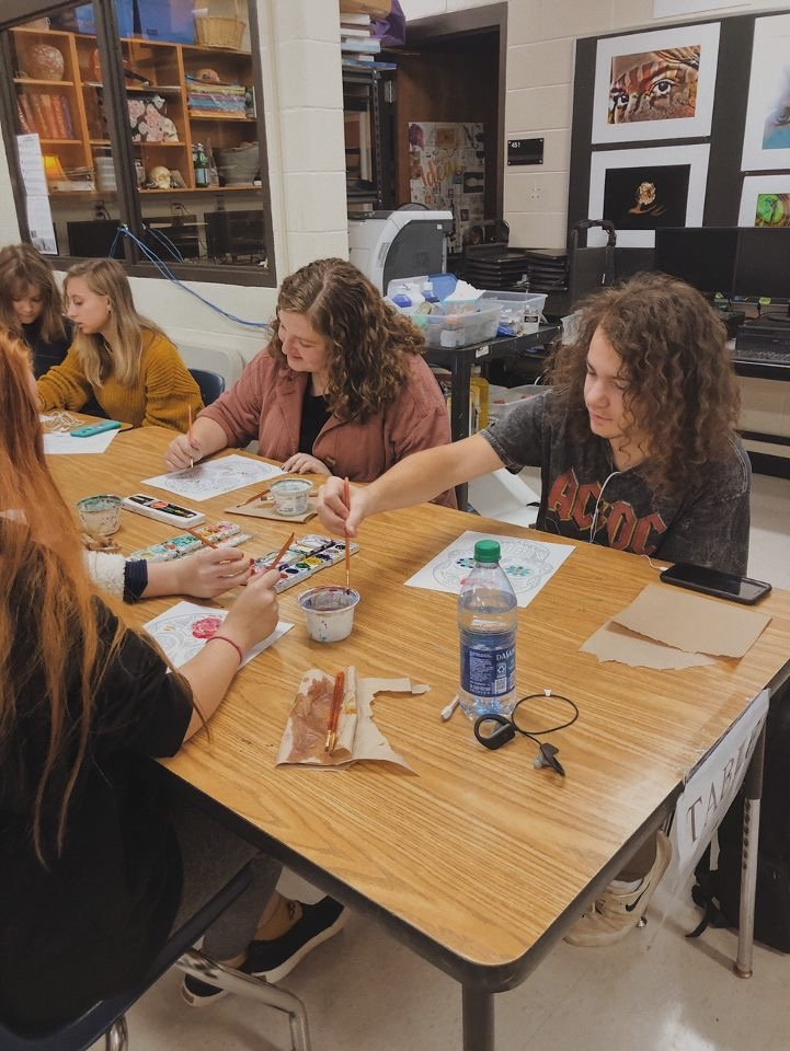 The art club works on their Day of the Dead project.