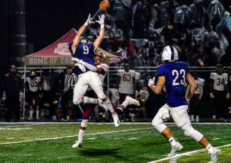 Nicky Dalmolin leaping to get a touchdown at the Playoffs on Nov. 8. Photo by: Ben Hendren