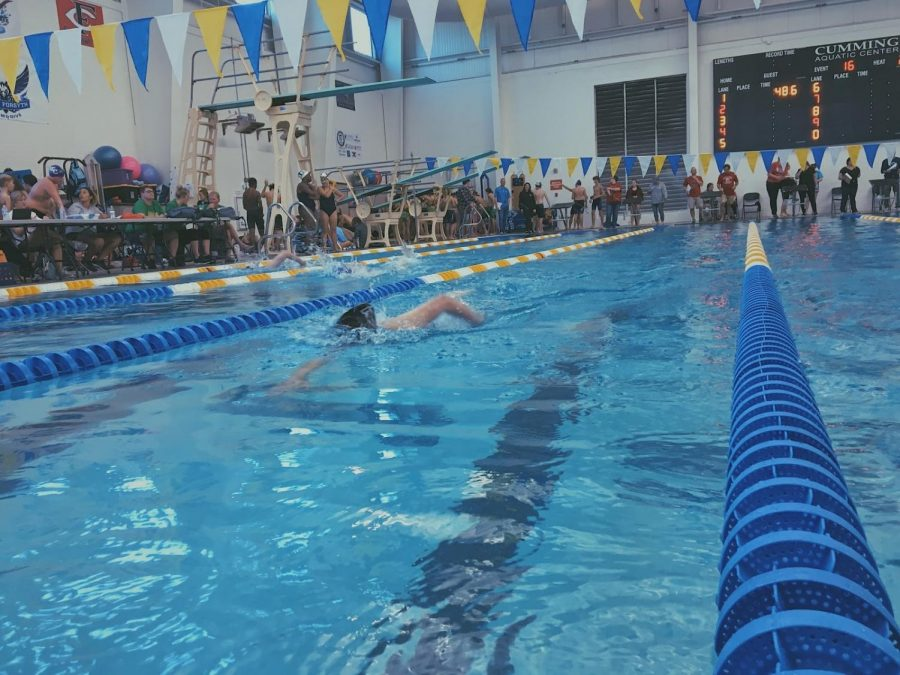 Julia Wickman swims her 500 meter freestyle. Photo by; Peyton Stenander