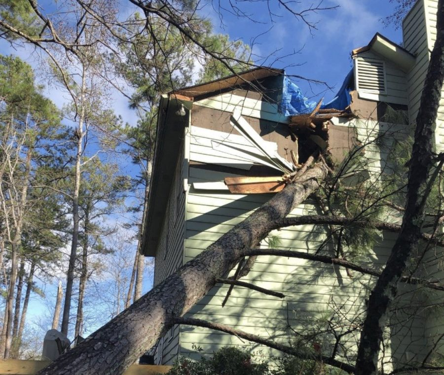 Here is a tree that fell on a two-story home because of high winds Source: National Weather Service