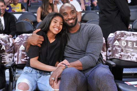 A famous picture of Kobe and Gianna Bryant at a basketball game is circulating the internet after the news of their passing.  Photo by DailySnark.com.