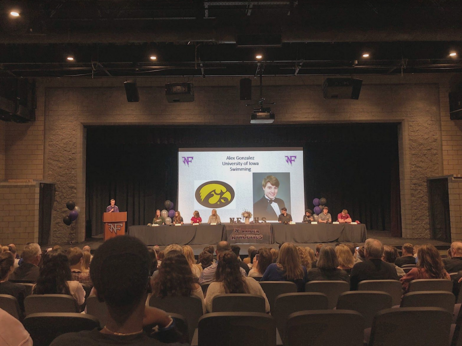 Coach Tyler Martin introduces the crowd to Alex Gonzalez at the North Forsyth High school signing ceremony (Photo By: Peyton Stenander).
