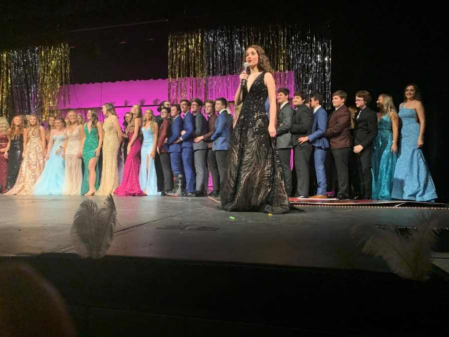 Everyone on stage for the Prom Fashion Show King and Queen to be revealed.