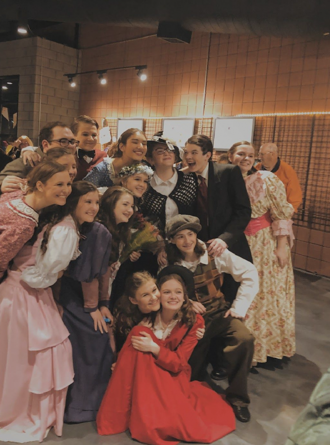 Some of the cast posed in the lobby after a successful opening night on March 5 before completing two more shows that weekend. (Photo By: Peyton Stenander).