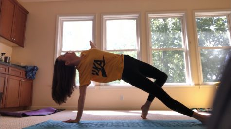 Freshman Varsity Swimmer Julia Wickman practices yoga to remain fit during quarantine. The Swim Team is having a competition to see which group can complete the most amount of workouts or physical activities, and the winners receive a surprise.