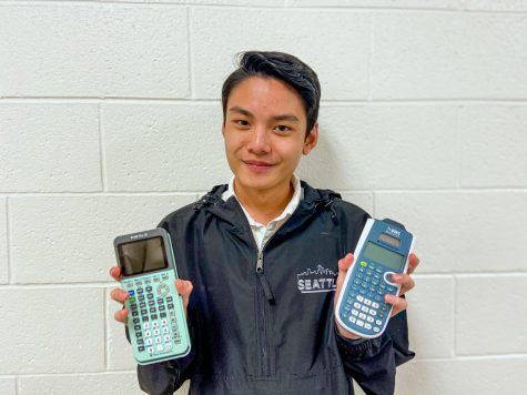 Sophomore Shawn Chansipaeng displays two commonly owned calculators that are accepted by the College Board. On the left, Chansipaeng holds the TI-84 Plus CE calculator, and on the right, he has the TI-30XS Multiview in hand. Photo by Sarah Treusch