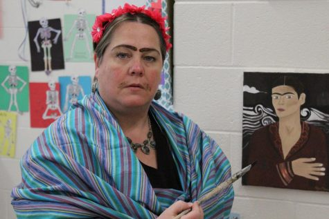 Aponte dresses up as Frida Kahlo for her students as they learn about Frida Kahlo and her life. Photo by Sydney Jarrard.