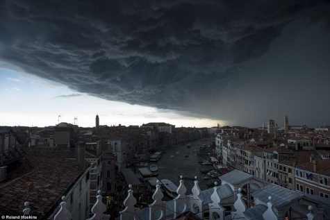 The dark clouds roll over a town as everyone waits for the clear skies to return. Photo from Dailymail.co.uk.