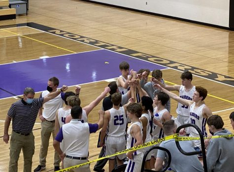 Coach Sokol peps the players up before the third quarter begins. Photo by Melody Scott.