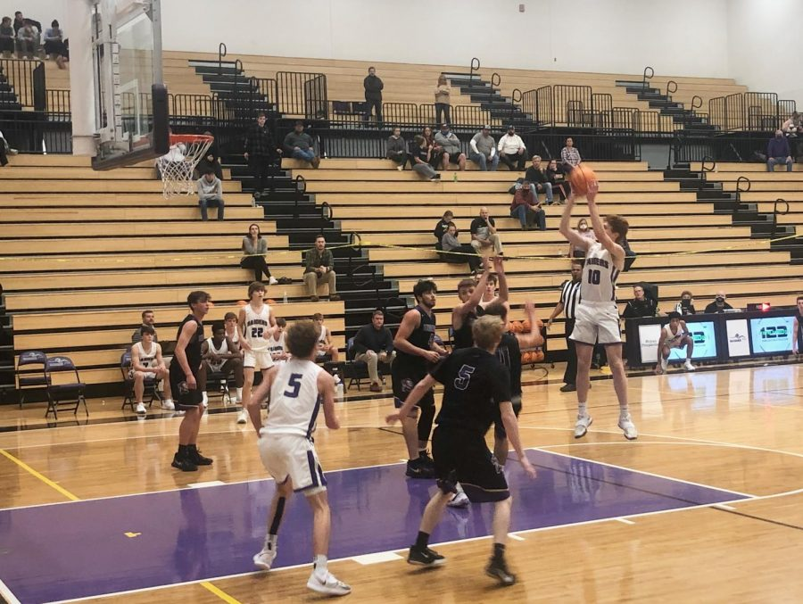 Junior Aiden Kudlas, #10, scores a free throw in the game against Lumpkin in Raider Arena. Photo by: Elizabeth Wood.