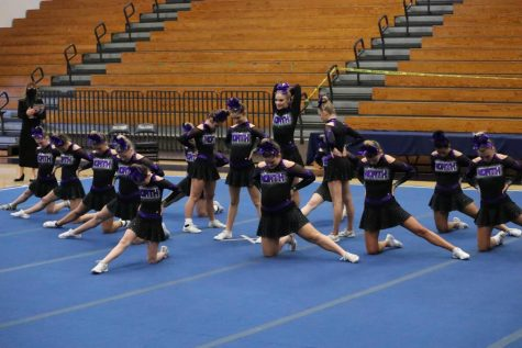 The beginning stance of the competition girls routine.