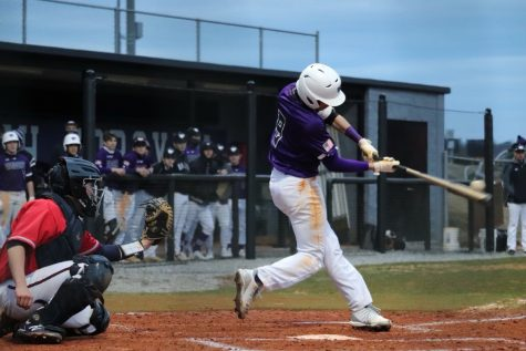 Michael Sills hits a line drive into right driving in the first run of the game. Photo by Savannah Stegeman.