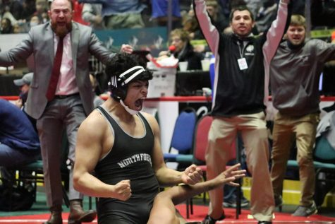 Victor Reyes after winning his match to advance him to placement matches. Photo by: Sydney Jarrard