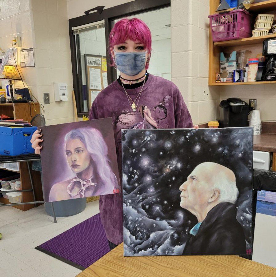 Senior Elizabeth Brady with two of her many AP Art pieces. Photo by: Cynda Allen.