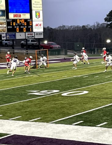 Senior #49, Carson Brown, awaits in goal as Dunwoody is on the attack. Photo by Drew Bearden.