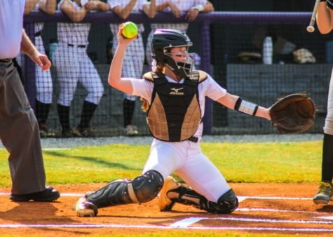 Junior Abby Castleberry, #32, hits the ball to help score points for the North Forsyth Raider Varsity softball team. Photo by: Emmelyn Harrison