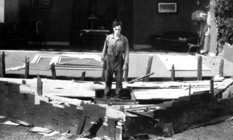 The aftermath of Keaton's most iconic stunt involving the frame of a house falling as he stays safe by standing in the path of an open window. Photo by: Charles Reisner.